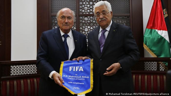 Former FIFA President Sepp Blatter with Palestine President Mahmoud Abbas