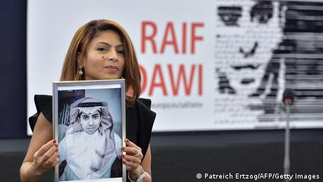 Ensaf Haidar holds a picture of her husband Raif Badawi after accepting the European Parliament's Sakharov human rights prize on behalf of her husband.