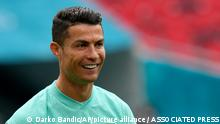 Portugal's Cristiano Ronaldo smiles during a team training session at the Ferenc Puskas stadium in Budapest, Monday, June 14, 2021 the day before the Euro 2020 soccer championship group F match between Hungary and Portugal. (AP Photo/Darko Bandic)