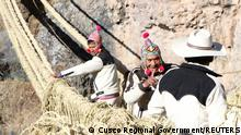 Members of the Huinchiri community rebuild an Incan hanging bridge, known as the Qeswachaka bridge, using traditional weaving techniques in Canas, Peru, June 13, 2021. Picture taken June 13, 2021. Cusco Regional Government/Handout via REUTERS ATTENTION EDITORS - THIS IMAGE HAS BEEN SUPPLIED BY A THIRD PARTY. NO RESALES. NO ARCHIVES