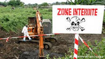 Experts work to remove toxic waste at a site near Akuedo village, Ivory Coast