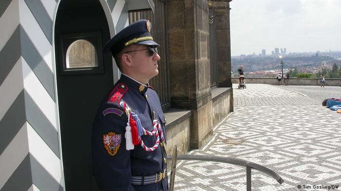 Prague, soldier in uniform standing guard by a guard house