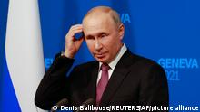 Russia's President Vladimir Putin addresses the media during a press conference after the U.S.-Russia summit with U.S. President Joe Biden at Villa La Grange in Geneva, Switzerland, Wednesday, June 16, 2021. (Denis Balibouse/Pool Photo via AP)