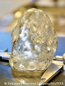 A 1,098 carat diamond, discovered in Botswana and believed to be the third largest gem-quality stone ever to be mined, is seen in this undated handout picture received June 16, 2021.