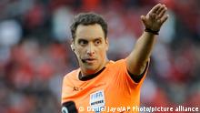 Referee Fernando Rapallini gestures during an Argentine first division soccer game between River Plate and Boca Juniors in Buenos Aires, Argentina, Sunday, Sept. 1, 2019. (AP Photo/Daniel Jayo)