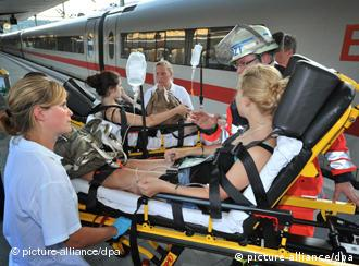 A student is treated on a train platform in Bielefeld