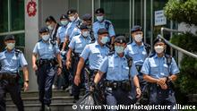 Police Officers are seen leaving the headquarters of the Apple Daily newspaper and its publisher Next Digital Ltd. in Hong Kong, China, on Thursday, June 17, 2021. Hong Kong's national security police arrested five executives of the pro-democracy Apple Daily newspaper for suspected breaches of the national security law, local news outlets reported Thursday, as the government escalated its campaign against well-known activist and media tycoonJimmy Lai. (Photo by Vernon Yuen/NurPhoto)