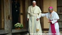 Pope Francis (C) is accompanied by the Bishop of Daejon, Lazarus You Heung-sik (R), as he visits to the Shrine of Solmoe, birthplace of Saint Andrew Kim Taegon, in Dangjin on August 15, 2014. Pope Francis warned of the cancer of despair that afflicts outwardly affluent societies and called on South Korean Catholics to reject inhuman economic models at a mass for 45,000 people earlier on August 15 on the first papal trip to Asia in 15 years. AFP PHOTO / VINCENZO PINTO (Photo credit should read VINCENZO PINTO/AFP via Getty Images)