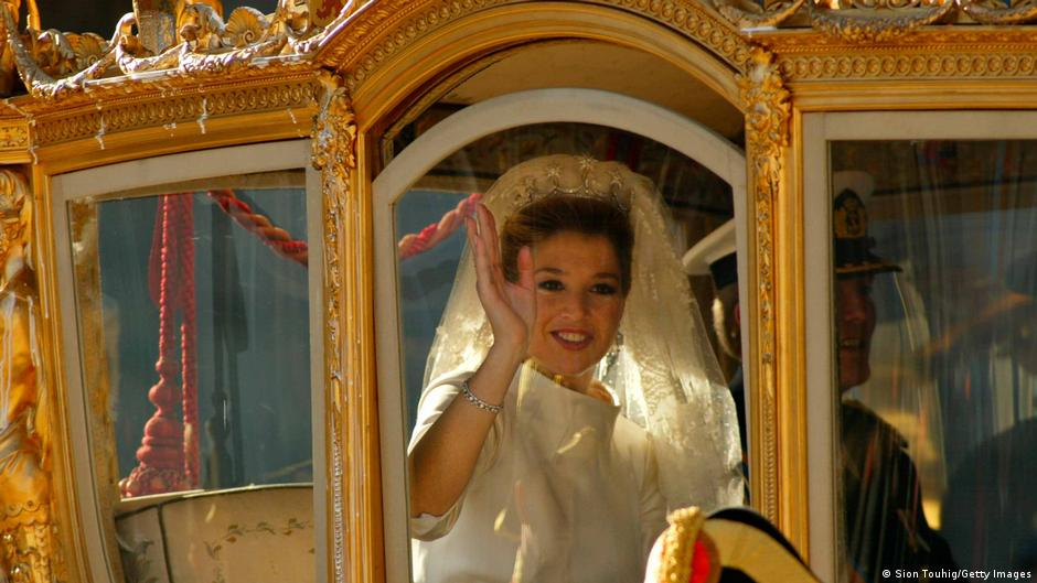 Dutch Crown Princess Maxima Zorreguieta waves from the Golden Coach after her wedding to Crown Prince Willem Alexander February 2, 2002.
