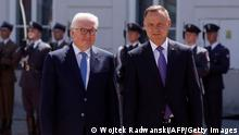 German President Frank-Walter Steinmeier (L) and Polish President Andrzej Duda (R) walk side by side during a welcoming ceremony at the presidential palace in Warsaw, Poland, on June 17, 2021. - The German President has travelled for a one-day visit to Warsaw on the occasion of the 30th anniversary of the German-Polish neighborhood treaty. (Photo by Wojtek Radwanski / AFP) (Photo by WOJTEK RADWANSKI/AFP via Getty Images)