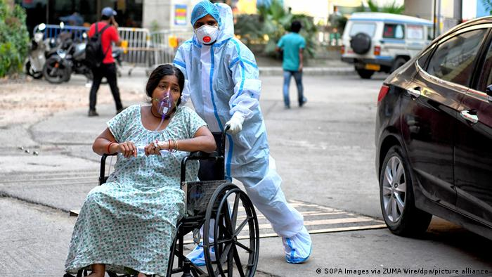 A wheelchair-bound COVID patient is being admitted to Kolkata Medical College Hospital