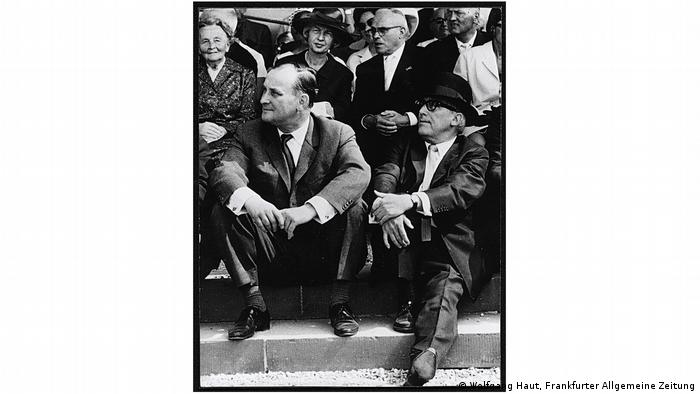 Werner Haftmann and Arnold Bode, two men sitting on steps outdoors