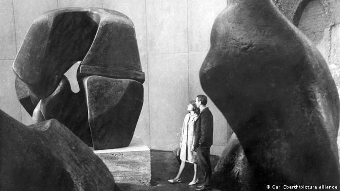 Visitors marvel at huge artworks.