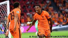 Soccer Football - Euro 2020 - Group C - Netherlands v Austria - Johan Cruijff ArenA, Amsterdam, Netherlands - June 17, 2021 Netherlands' Denzel Dumfries celebrates scoring their second goal Pool via REUTERS/Piroschka Van De Wouw