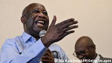 Former Ivorian president Laurent Gbagbo (L) gestures as he speaks to supporters at the Ivorian Popular Front (FPI) offices in Abidjan on June 17, 2021. - Ivory Coast's former president Laurent Gbagbo returned home on June 17, 2021 for the first time in a decade after being acquitted by the International Criminal Court (ICC) of crimes against humanity. (Photo by Sia KAMBOU / AFP) (Photo by SIA KAMBOU/AFP via Getty Images)
