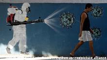 December 21, 2020, Rio de Janeiro, Brasil: RI Rio de Janeiro, RJ - 24/06/2020 Grafitti no Bairro do Estácio, Zona Norte do Rio de Janeiro, com o rosto do Presidente Jair Bolsonaro como coronavírus sendo higienizado. Foto Luiza Moraes / Agência O Globo (Credit Image: © O Globo/GDA via ZUMA Wire
