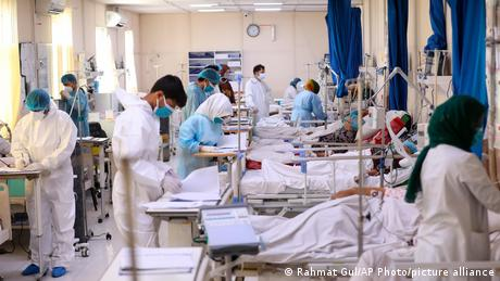 Doctors treat COVID-19 patients at a hospital in Kabul