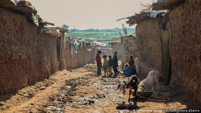 Afghan refugee children are seen at Afghan Basti refugee camp on a winter day outside Islamabad, Pakistan