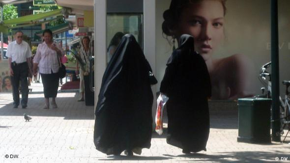 Two fully veiled Muslim women on the streets of Bonn, Germany