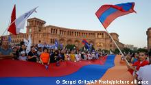 Supporters of the former President Robert Kocharyan attend a rally in his support prior to upcoming parliamentary elections in the center of Yerevan, Armenia, Friday, June 18, 2021. Armenian voters will go to the polls for early parliamentary elections on Sunday, June 20, 2021. (AP Photo/Sergei Grits)