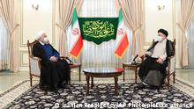 19.06.2021 *** In this photo released by the official website of the office of the Iranian Presidency, President Hassan Rouhani, left, and President-elect Ebrahim Raisi, who is current judiciary chief, talk during their meeting in Tehran, Iran, Saturday, June 19, 2021. Iran's hard-line judiciary chief won the country's presidential election in a landslide victory Saturday, propelling the supreme leader's protege into Tehran's highest civilian position in a vote that appeared to see the lowest turnout in the Islamic Republic's history. (Iranian Presidency Office via AP)