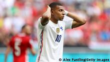 BUDAPEST, HUNGARY - JUNE 19: Kylian Mbappe of France reacts after missing a chance during the UEFA Euro 2020 Championship Group F match between Hungary and France at Puskas Arena on June 19, 2021 in Budapest, Hungary. (Photo by Alex Pantling/Getty Images)