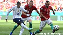 BUDAPEST, HUNGARY - JUNE 19: Ousmane Dembele of France hits the post from a shot whilst under pressure from Attila Szalai and Attila Fiola of Hungary during the UEFA Euro 2020 Championship Group F match between Hungary and France at Puskas Arena on June 19, 2021 in Budapest, Hungary. (Photo by Tibor Illyes - Pool/Getty Images)