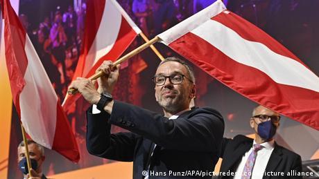 Herbert Kickl waving the Austrian flag
