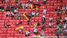 Germany fans wait for the start of the UEFA EURO 2020 Group F football match between Portugal and Germany at Allianz Arena in Munich on June 19, 2021. (Photo by PHILIPP GUELLAND / POOL / AFP) (Photo by PHILIPP GUELLAND/POOL/AFP via Getty Images)