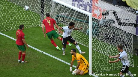 Germany's players celebrate after Portugal's Raphael Guerreiro scores an own goal