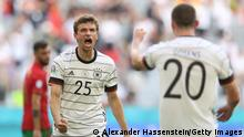 MUNICH, GERMANY - JUNE 19: Thomas Mueller of Germany celebrates their side's third goal scored by team mates Kai Havertz (not pictured) during the UEFA Euro 2020 Championship Group F match between Portugal and Germany at Football Arena Munich on June 19, 2021 in Munich, Germany. (Photo by Alexander Hassenstein/Getty Images)