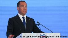 MOSCOW, RUSSIA - JUNE 19, 2021: Russian Security Council Deputy Chairman, United Russia Party Chairman Dmitry Medvedev addresses a plenary meeting during Phase 1 of the 20th conference of the United Russia Party at ExpoCentre, before the forthcoming Russian State Duma election, which is scheduled for 19 September 2021. The United Russia Party convened to draft its election strategy and consider candidates. Sergei Karpukhin/TASS