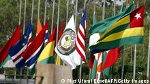 Flags of ECOWAS member countries fly at half mast to honour late Togolese President Gnassingbe Eyadema at the Lome headquater of the ECOWAS bank for investment and development, 08 February 2005. Eyadema was a founding member of the West African sub-regional organization. Meanwhile, the Togolese capital has remain calm and quiet, but gripped with fear and suspicion as several shops have been closed in compliance with the sit-at-home ordered by the opposition in protest of the alleged military coup that facilitated the ascension to power and succession of President Faure Gnassingbe to his father and late President Gnassingbe Eyadema. AFP PHOTO PIUS UTOMI EKPEI (Photo by - / AFP) (Photo by -/AFP via Getty Images)