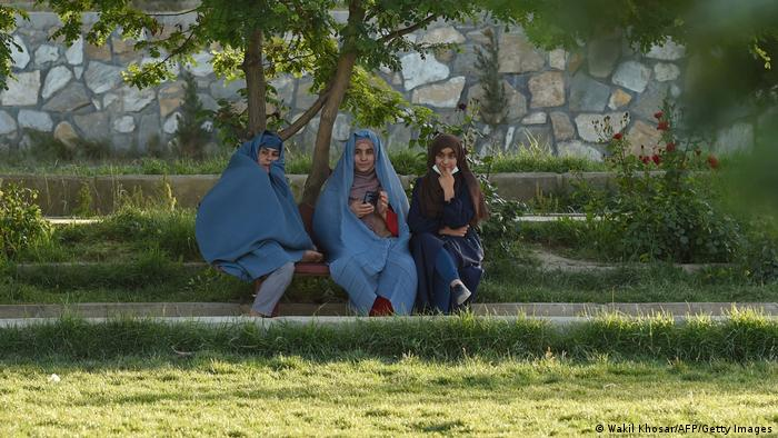 Women sit in a park for picnic in Ghazni on June 3, 2021