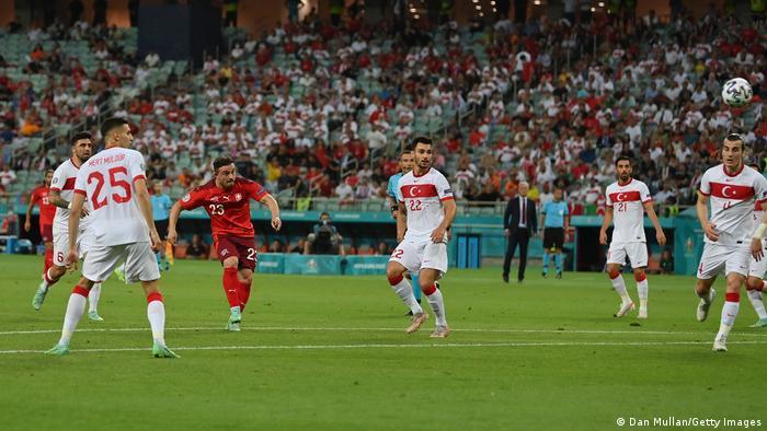 Xherdan Shaqiri thunders home the first of his two goals against Turkey in Baku.