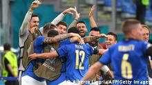 Italy's midfielder Matteo Pessina (C) celebrates the first goal with teammates during the UEFA EURO 2020 Group A football match between Italy and Wales at the Olympic Stadium in Rome on June 20, 2021. (Photo by ALBERTO LINGRIA / POOL / AFP) (Photo by ALBERTO LINGRIA/POOL/AFP via Getty Images)