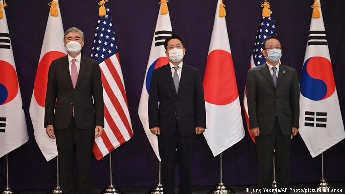 From left, U.S. special representative for North Korea Sung Kim, South Korea's Special Representative for Korean Peninsula Peace and Security Affairs Noh Kyu-duk and Japanese Foreign Ministry's Director-General of the Asian and Oceanian Affairs Bureau Takehiro Funakoshi pose in front of their flags