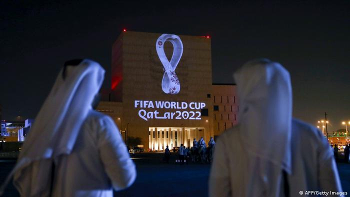 Qataris gather at the capital Doha's traditional Souq Waqif market as the official logo of the FIFA World Cup Qatar 2022 is projected on the front of a building on September 3, 2019.