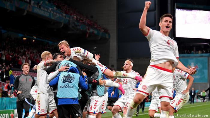 Danish delirium: Denmark's players celebrate their third goal against Russia