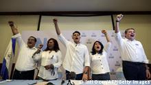 Members of the newly-created National Coalition, Felix Maradiaga (L), Daysi George (2-L), Lesther Aleman (C), Ivania Alvarez (2-R) and Juan Sebastian Chamorro (R), raise their clenched fists during a press conference in Managua on January 17, 2020. - Leaders of the opposition National Unity party and the Civic Alliance for Justice and Democracy party convened a press conference to announce their union and the creation of the National Coalition, whose objective is to face Nicaragua's President Daniel Ortega's government on the next national elections. (Photo by INTI OCON / AFP) (Photo by INTI OCON/AFP via Getty Images)