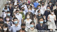 Scene from North Korea People wearing masks commute to work in Pyongyang on June 17, 2021, amid concerns over the coronavirus. PUBLICATIONxINxGERxSUIxAUTxHUNxONLY