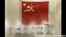 BEIJING, CHINA - OCTOBER 17: (CHINA OUT) Portraits of Chinese Communists (L-R), Qin Bangxian, Zhang Wentian, Zhou Enlai, Chen Yun, Zhu De, Mao Zedong and a former flag of the Communist Party of China are displayed during Road Of Revival Exhibition about the rejuvenation of China at the Military Museum of Chinese People's Revolution October 17, 2007 in Beijing, China. The exhibition displayed cultural relics, pictures and documents featuring important historical events in China since 1840, when the nation was defeated in the Opium War. (Photo by China Photos/Getty Images)