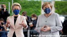 German Chancellor Angela Merkel, right, welcomes Ursula von der Leyen, left, President of the European Commission, for a meeting at the chancellery in Berlin, Germany, Tuesday, June 22, 2021. (AP Photo/Michael Sohn)