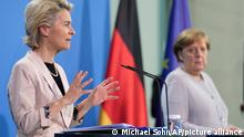 German Chancellor Angela Merkel, right, and Ursula von der Leyen, left, President of the European Commission, address the media during a joint press conference after a meeting in Berlin, Germany, Tuesday, June 22, 2021. (AP Photo/Michael Sohn, Pool)