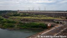 View of Itaipu binational hydroelectric dam on the Parana river, natural border between Paraguay and Brazil, as seen from Itaipu, Paraguay on December 21, 2018. - Paraguay will inaugurate in January the first green route of South America to provide electrical supply with solar energy for electric vehicles along 1,000 km, linking the country's main cities Asuncion, Ciudad del Este (border with Brazil) and Encarnacion (border with Argentina ) authorities said. (Photo by Norberto DUARTE / AFP)