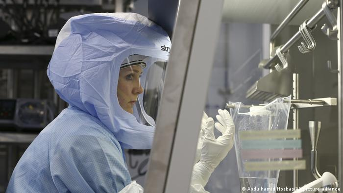 Employee of German company BioNTech in special suit