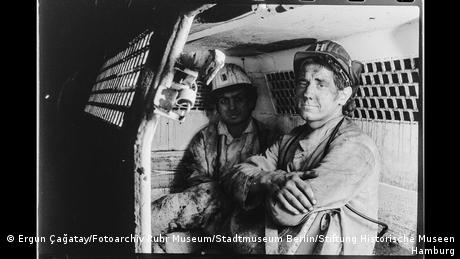 Two miners in a passenger car at Walsum colliery, Duisburg.