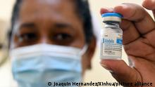 (210515) -- HAVANA, May 15, 2021 (Xinhua) -- A medical worker displays a vial of Abdala, a homemade COVID-19 vaccine, at a vaccination site in Havana, Cuba, on May 14, 2021. Cuba on Wednesday began a mass vaccination campaign against COVID-19 in the country's capital of Havana as part of an intervention study of homemade vaccine candidates. At present, phase 3 clinical trials for Cuban COVID-19 vaccine candidates Soberana-02 and Abdala are underway, so are intervention studies involving frontline workers from across the country. (Photo by Joaquin Hernandez/Xinhua)
