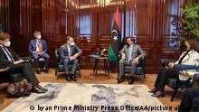 BERLIN, GERMANY - JUNE 22: (----EDITORIAL USE ONLY – MANDATORY CREDIT - LIBYAN PRIME MINISTRY PRESS OFFICE / HANDOUT - NO MARKETING NO ADVERTISING CAMPAIGNS - DISTRIBUTED AS A SERVICE TO CLIENTS----) Libyan Prime Minister Abdul Hamid Dbeibeh (2nd R) welcomed by German Foreign Minister Heiko Mass (3rd L) during an official visit to Berlin, Germany on June 22, 2021. Libyan Foreign Minister Najla Mangoush (R) also attended the meeting. Libyan Prime Ministry Press Office/Handout / Anadolu Agency