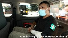 July 6, 2020, Hong Kong, China: TONG YING-KIT, a volunteer First Aid medic, sits in a Police van as he is taken to West Kowloon Court. He is the first person charged with 'inciting secession and engaging in terrorism' under Hong Kong's new National Security law. On July 1st, the anniversary of Hong Kong's handover, Tong drove a motorcycle through group of Riot Police, causing injuries to the policemen. (Credit Image: © Eddie Stringer/ZUMA Wire